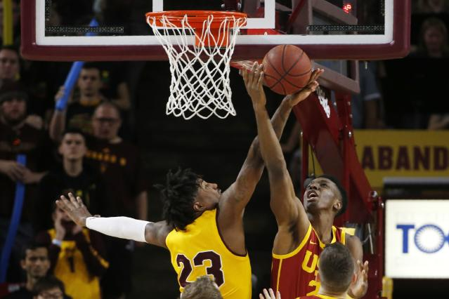 Arizona State forward Romello White (23) blocks a shot by Southern California forward Onyeka Okongwu, right, during the second half of an NCAA college basketball game Saturday, Feb. 8, 2020, in Tempe, Ariz. Arizona State won 66-64. (AP Photo/Ross D. Franklin)
