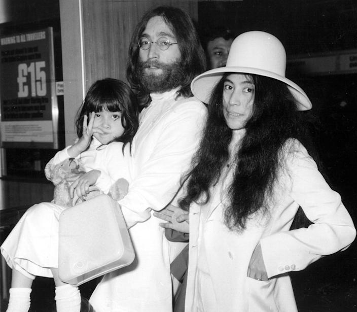 Yoko Ono with John Lennon at London's Heathrow airport in 1969. With them is Kyoko, Yoko's daughter from her previous marriage (Getty Images)