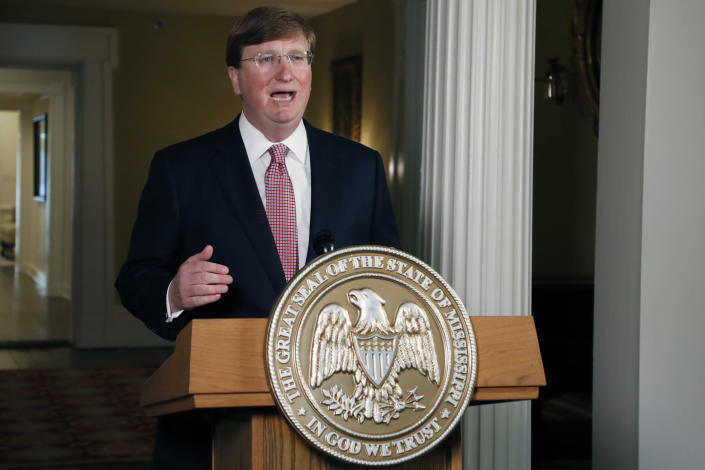 Mississippi Gov. Tate Reeves delivers a televised address prior to signing a bill retiring the last state flag in the United States with the Confederate battle emblem, during a ceremony at the Governor's Mansion in Jackson, Miss., Tuesday, June 30, 2020. The legislation passed both chambers of the Legislature on Sunday. (AP Photo/Rogelio V. Solis, Pool)