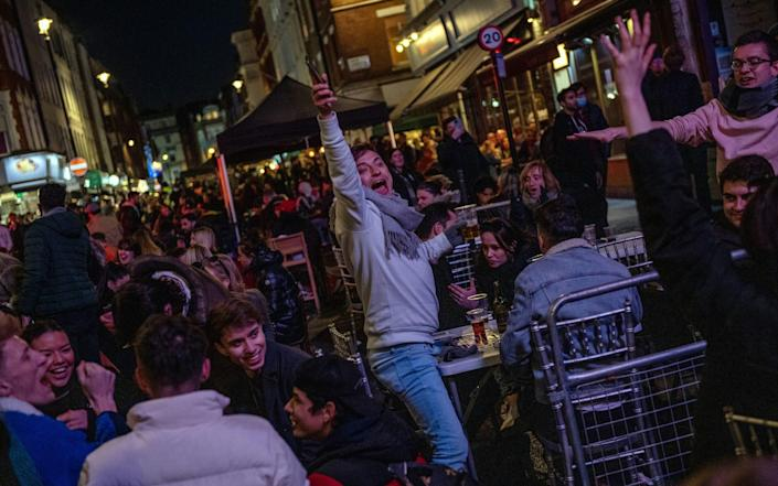 Revellers in Soho, London, when lockdown restrictions eased on April 12 - Chris J Ratcliffe/Getty Images