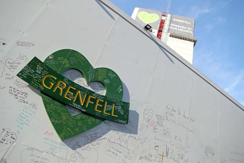 Tribute messages on a wall near the Grenfell Tower. (PA)