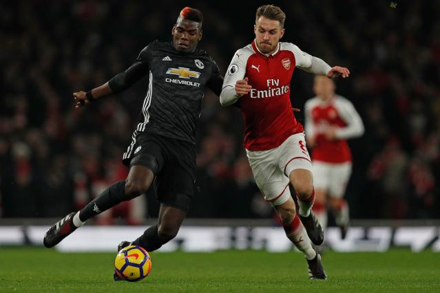 Paul Pogba and Aaron Ramsey battle during Manchester United's 3-1 win at Arsenal. (Getty)