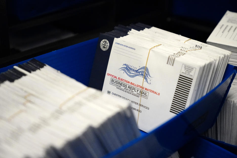 Mail-in ballots for the 2020 General Election in the United States are seen after being sorted at the Chester County Voter Services office on Oct. 23, 2020, in West Chester, Pa. (Matt Slocum/AP)