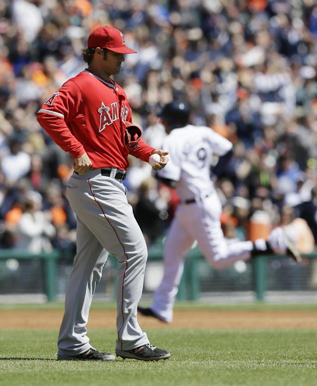 Los Angeles Angels starting pitcher C.J. Wilson walks on the mound as Detroit Tigers' Nick Castellanos rounds the bases after his two-run home run during the second inning of a baseball game in Detroit, Saturday, April 19, 2014. (AP Photo/Carlos Osorio)