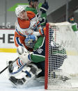 Edmonton Oilers right wing Josh Archibald (15) crashes into Vancouver Canucks goaltender Thatcher Demko (35) during the first period of an NHL hockey game Thursday, Feb. 25, 2021, in Vancouver, British Columbia. (Jonathan Hayward/The Canadian Press via AP)
