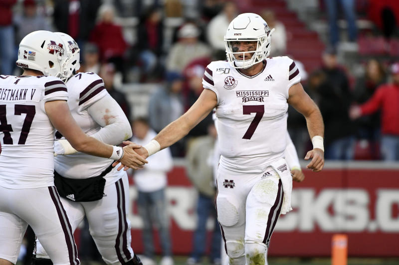 Mississippi State quarterback Tommy Stevens heads off the field after a touchdown against Arkansas during the second half of an NCAA college football game, Saturday, Nov. 2, 2019 in Fayetteville, Ark. (AP Photo/Michael Woods)