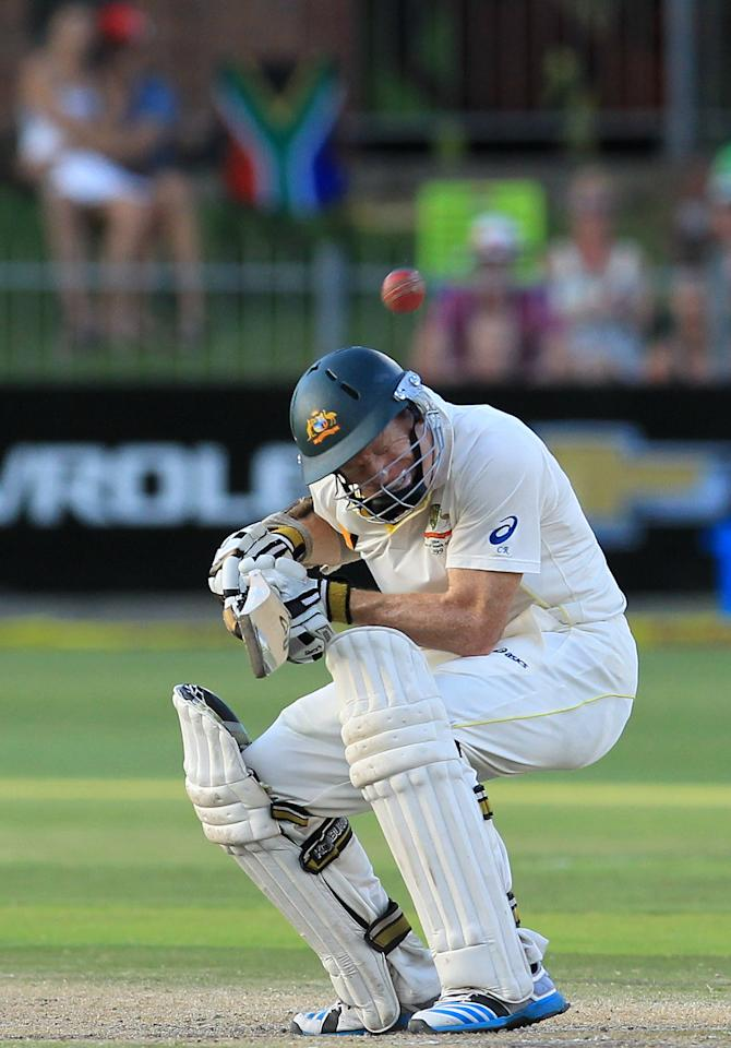 Australia's batsman Chris Rogers ducks under a bouncer from South Africa's bowler Dale Steyn, on the fourth day of their second cricket test match at St George's Park in Port Elizabeth, South Africa, Sunday, Feb. 23, 2014. (AP Photo/ Themba Hadebe)