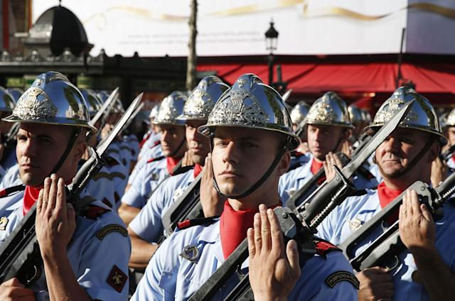 <p>Paris' firefighters gather for the start of the annual Bastille Day military parade on the Champs-Elysees avenue in Paris on July 14, 2017. (Photo: Geoffroy Van Der Hasselt/AFP/Getty Images) </p>
