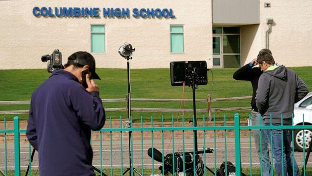PHOTO: Members of the media gather outside Columbine High School after some Denver area schools closed during a police search for an armed woman 'infatuated' with the Columbine massacre, in Littleton, Colo., April 17, 2019. (Rick Wilking/Reuters)