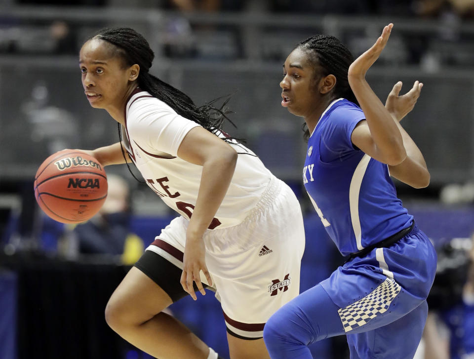 Mississippi State guard Nyah Tate, left, drives past Kentucky guard Taylor Murray in the second half of an NCAA college basketball game at the women's Southeastern Conference tournament Friday, March 2, 2018, in Nashville, Tenn. Mississippi State won 81-58. (AP Photo/Mark Humphrey)
