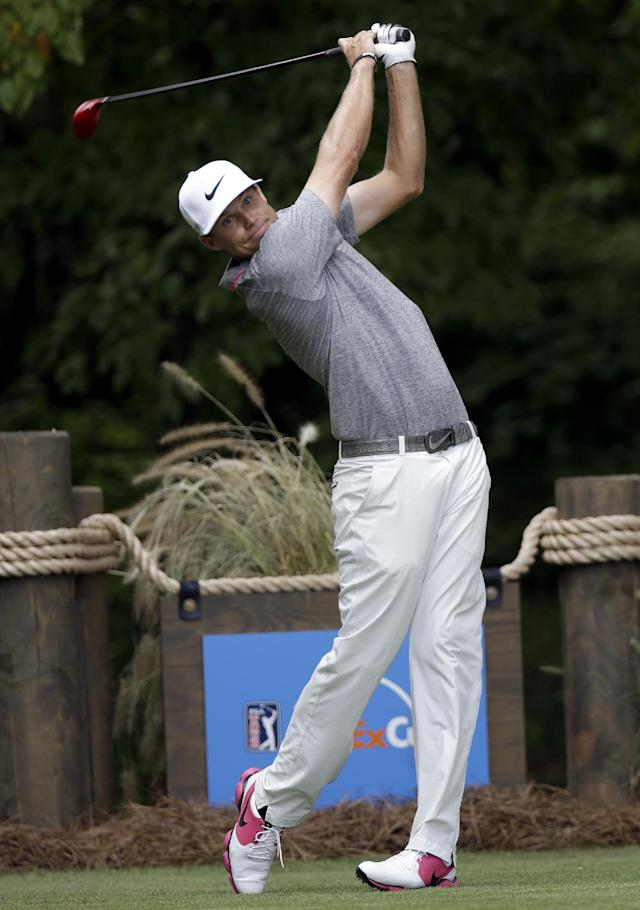 Nick Watney hits a tee shot on the second hole during the final round of the Wyndham Championship golf tournament in Greensboro, N.C., Sunday, Aug. 17, 2014. (AP Photo/Gerry Broome)