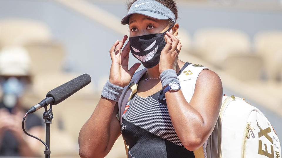 Naomi Osaka, pictured here conducting an on-court interview after her victory over Patricia Maria Tig at the French Open.