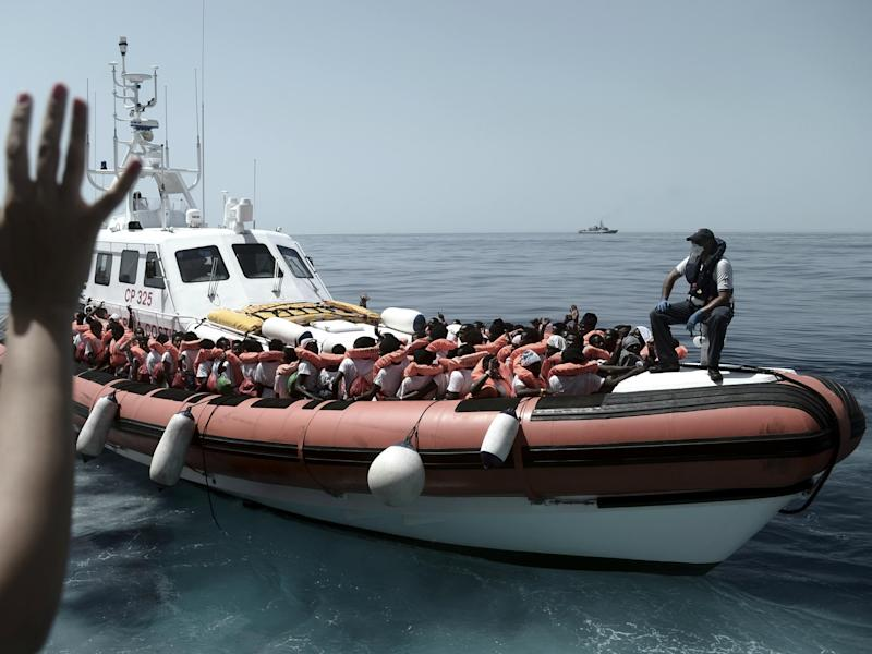 Stranded refugees on an Italian coastguard boat as they are transferred from the Aquarius to Italian ships to continue the journey to Spain: AP