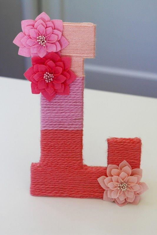 """<p>Use your darling's first initial to make this cute ombre display.</p><p><strong>Get the tutorial at <a href=""""http://catchmyparty.com/blog/diy-how-to-make-a-yarn-wrapped-ombre-monogrammed-letter"""" rel=""""nofollow noopener"""" target=""""_blank"""" data-ylk=""""slk:Catch My Party"""" class=""""link rapid-noclick-resp"""">Catch My Party</a>.</strong> </p><p><strong><a class=""""link rapid-noclick-resp"""" href=""""https://www.amazon.com/slp/wood-letter/bqqxeufu5wyh7av?tag=syn-yahoo-20&ascsubtag=%5Bartid%7C10050.g.2971%5Bsrc%7Cyahoo-us"""" rel=""""nofollow noopener"""" target=""""_blank"""" data-ylk=""""slk:SHOP WOOD LETTERS"""">SHOP WOOD LETTERS</a><br></strong></p>"""