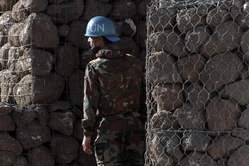 A UN soldier stands next to a shelter inside a UN base near the Quneitra crossing between the Israeli-controlled Golan Heights and Syria Friday, June 7, 2013. Syrian rebels on Thursday briefly captured a crossing point along a cease-fire line with Israel in the contested Golan Heights. (AP Photo/Sebastian Scheiner)