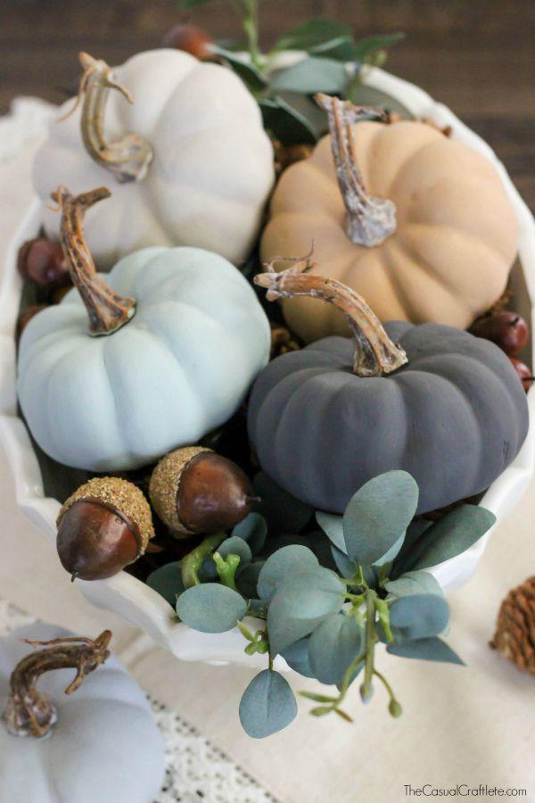 """<p>A coat of chalk paint takes mini pumpkins from cute to cool. Loop in another trend by adding succulents to the centerpiece. </p><p><em><a href=""""http://www.thecasualcraftlete.com/2015/09/08/vintage-inspired-chalky-paint-pumpkins/"""" rel=""""nofollow noopener"""" target=""""_blank"""" data-ylk=""""slk:Get the tutorial at The Casual Craftlete »"""" class=""""link rapid-noclick-resp"""">Get the tutorial at The Casual Craftlete »</a></em></p>"""