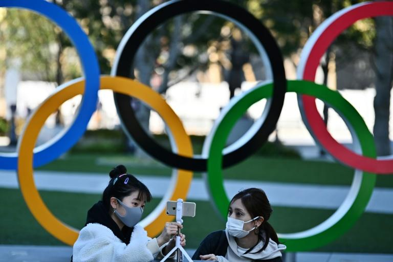 The virus outbreak has cast a shadow over preparations for the Olympics, which Tokyo will host from July (AFP Photo/CHARLY TRIBALLEAU)