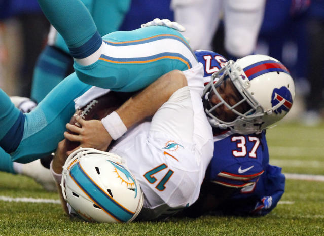 Buffalo Bills defensive back Nickell Robey (37) sacks Miami Dolphins quarterback Ryan Tannehill (17) during the second half of an NFL football game on Sunday, Dec. 22, 2013, in Orchard Park, N.Y. Buffalo won 19-0. (AP Photo/Bill Wippert)