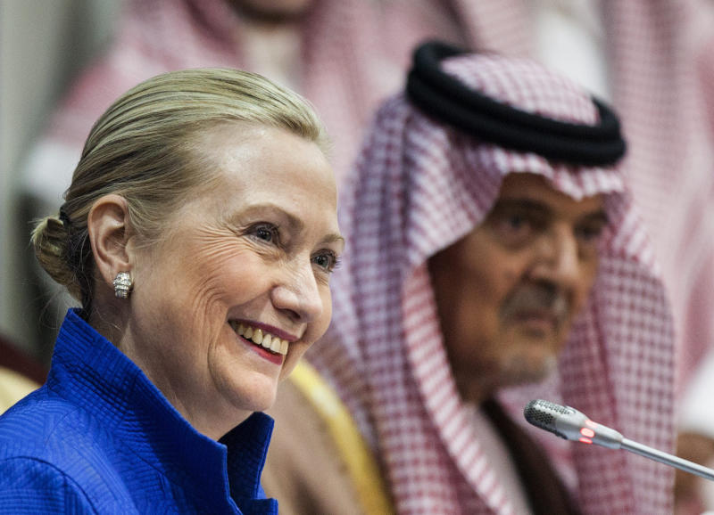 U.S. Secretary of State Hillary Clinton smiles during a joint press conference with Saudi Foreign Minister Prince Saud al-Faisal following a U.S.-Gulf Cooperation Council forum at the GCC secretariat in Riyadh, Saudi Arabia on Saturday, March 31, 2012. Clinton geared up for talks in Saudi Arabia about plans for a Gulf missile shield against Iran and ways to press Tehran's ally Syria to stop killing Syrians. (AP Photo/Brendan Smialowski, Pool)