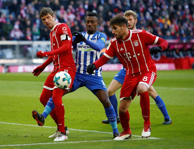 Soccer Football - Bundesliga - Bayern Munich vs Hertha BSC - Allianz Arena, Munich, Germany - February 24, 2018 Hertha Berlin's Salomon Kalou in action with Bayern Munich's Thomas Muller and Javi Martinez REUTERS/Michaela Rehle DFL RULES TO LIMIT THE ONLINE USAGE DURING MATCH TIME TO 15 PICTURES PER GAME. IMAGE SEQUENCES TO SIMULATE VIDEO IS NOT ALLOWED AT ANY TIME. FOR FURTHER QUERIES PLEASE CONTACT DFL DIRECTLY AT + 49 69 650050