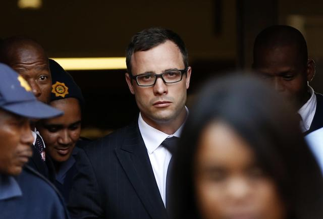 Paralympic track star Oscar Pistorius (C) leaves after listening to the closing arguments in his murder trial at the high court in Pretoria August 7, 2014. Pistorius, once a national icon for reaching the pinnacle of sport, is accused of murdering his law graduate and model girlfriend Reeva Steenkamp at his home in Pretoria on Valentine's Day last year. If found guilty of premeditated murder, he could face life in prison. A potential lesser charge of culpable homicide could carry a sentence of 15 years. REUTERS/Siphiwe Sibeko (SOUTH AFRICA - Tags: SPORT CRIME LAW ATHLETICS TPX IMAGES OF THE DAY)