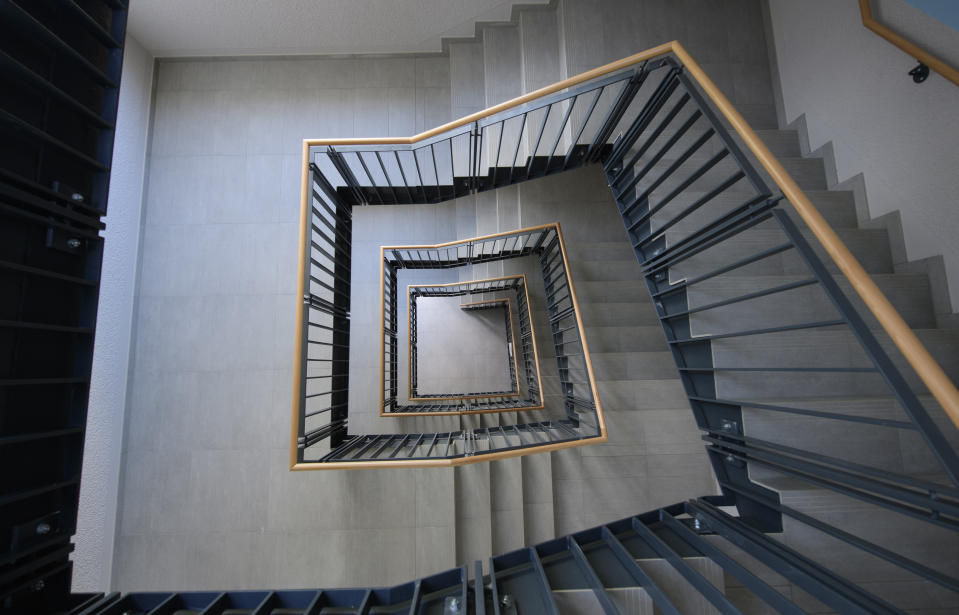 """25 June 2020, Saxony, Dresden: View into a staircase in a residential building with 22 newly built apartments. Today, the city-owned Dresdner Wohnungsbaugesellschaft """"Wohnen in Dresden"""" (WiD) took over the first residential building financed with subsidies from the Free State. The 22 newly built social housing units were subsidized with 1.04 million euros from the """"Gebundener Mietwohnraum"""" guideline of the Free State of Saxony. This means that WiD is starting to build up its own stock of social housing. Photo: Robert Michael/dpa-Zentralbild/ZB (Photo by Robert Michael/picture alliance via Getty Images)"""