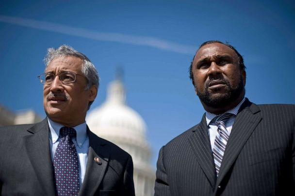 PHOTO: Rep. Bobby Scott, left, and John Boyd, Jr., president of the National Black Farmers Association, wait for the news conference to start on Wednesday, March 24, 2010, on the $1.15 billion Black farmers settlement. (Bill Clark/Getty Images, FILE)