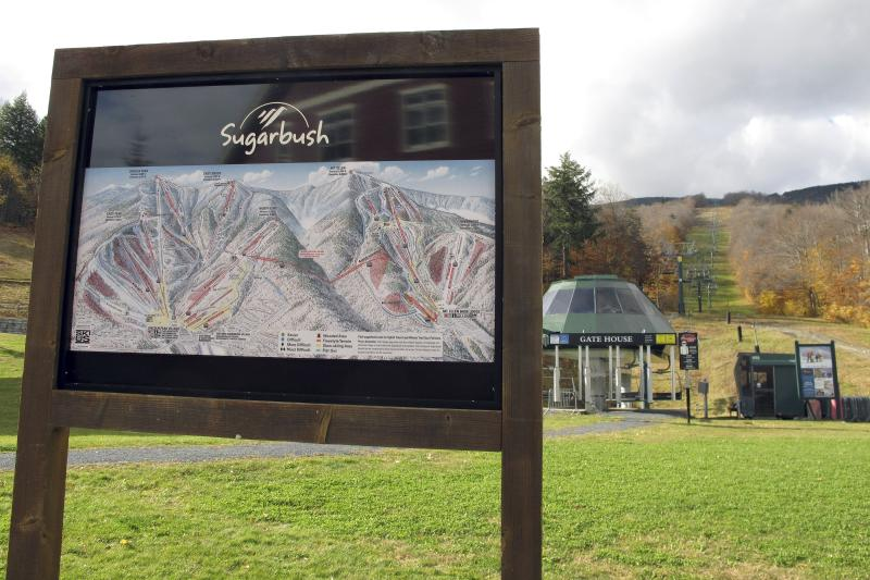 In this Oct. 23, 2019, photo, a trail map and ski slopes await the ski season at Sugarbush Resort in Warren, Vt. In the tight labor market, ski areas are having a tough time hiring seasonal workers so they're upping the ante by boosting wages, offering more worker housing and other incentives. (AP Photo/Lisa Rathke)