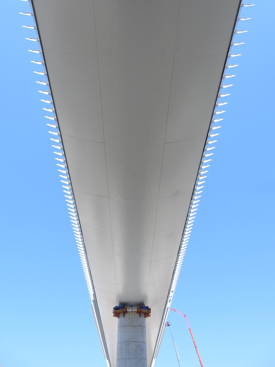 """<div class=""""caption""""> Piano designed the bridge to look like the curved hull of a ship when viewed from beneath. </div> <cite class=""""credit"""">Photo: Shunji Ishida</cite>"""