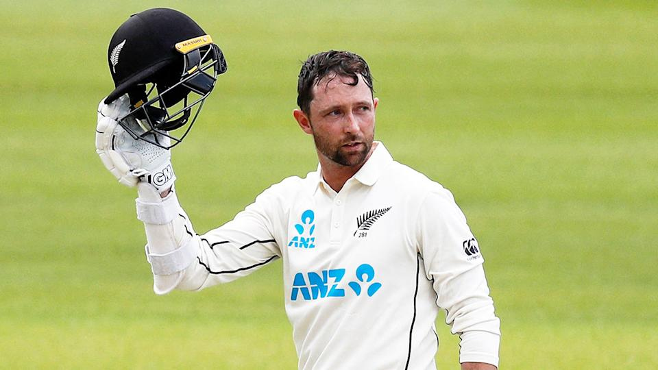 Seen here, Devon Conway salutes his teammates after a century on debut for New Zealand.