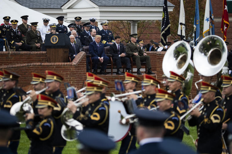 Seated front row from left; Vice President Mike Pence, President Donald Trump, Defense Secretary Mark Esper and former chairman Gen. Joseph Dunford watch the U.S. Army Band march during a ceremony welcoming Chairman of the Joint Chiefs of Staff Gen. Mark Milley, at Joint Base Myer-Henderson Hall, Va., Monday, Sept. 30, 2019. (AP Photo/Manuel Balce Ceneta)