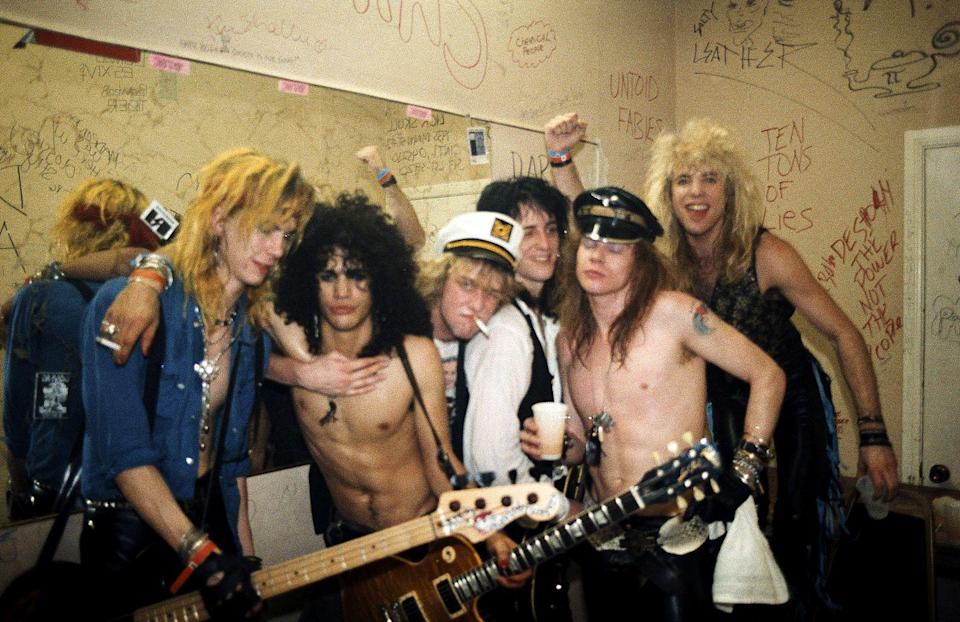 <p>Guns N' Roses—Duff McKagan, Slash, Izzy Stradlin, Axl Rose, and Steven Adler—pose for a portrait backstage on March 21, 1986 at Fenders Ballroom Long Beach, California five days before they signed to Geffen Records.</p>