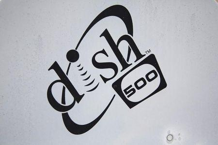 A Dish Network logo is seen on a satellite dish on a Brooklyn apartment building roof in New York