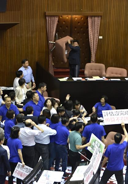 Friday's brawl followed repeated disruption on Thursday when rival legislators grabbed each other's throats in angry scuffles during a review of the budget for the project (AFP Photo/SAM YEH)