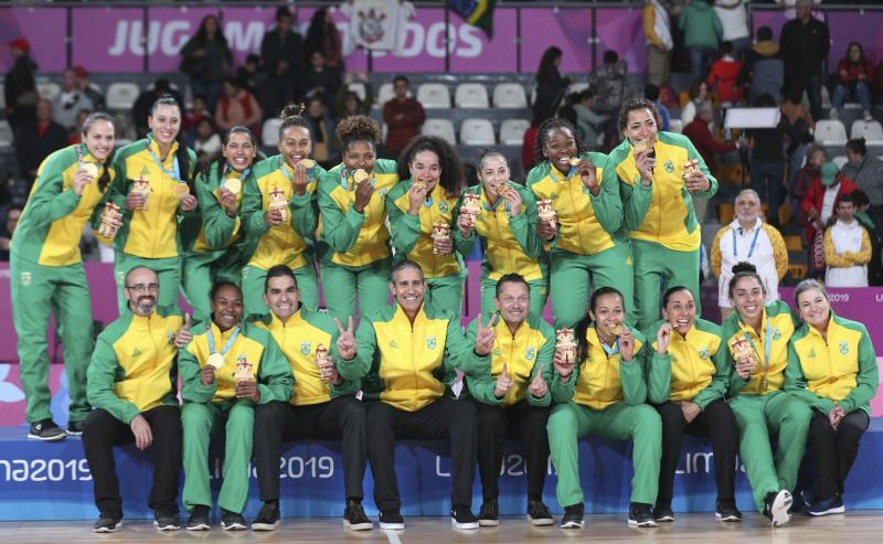 Brazil teammates pose at the winner's podium posing with their gold medals after defeating the United States in the women's basketball final game, at the Pan American Games in Lima, Peru, Saturday, Aug. 10, 2019. (AP Photo/Martin Mejia)