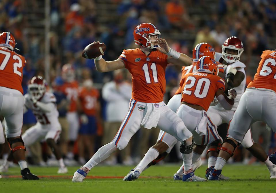 GAINESVILLE, FL - NOVEMBER 14: Kyle Trask #11 of the Florida Gators throws a pass against the Arkansas Razorbacks at Ben Hill Griffin Stadium on November 14, 2020 in Gainesville, Florida. (Photo by Courtney Culbreath/Collegiate Images/Getty Images)