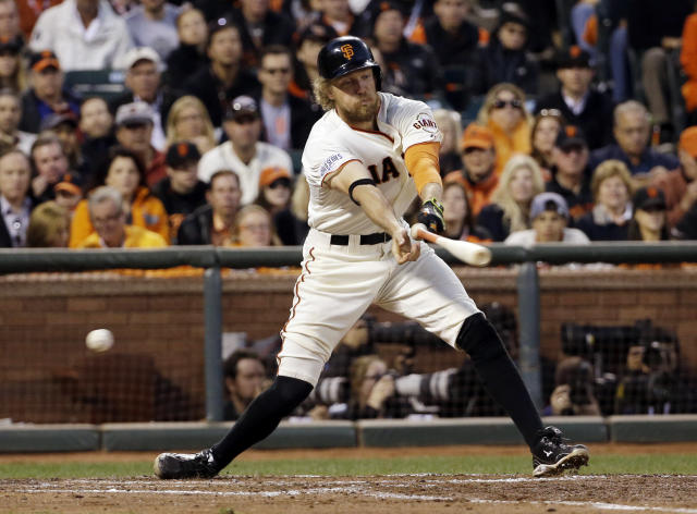 San Francisco Giants' Hunter Pence loses his bat as he strikes out during the fourth inning of Game 5 of baseball's World Series against the Kansas City Royals Sunday, Oct. 26, 2014, in San Francisco. (AP Photo/David J. Phillip)