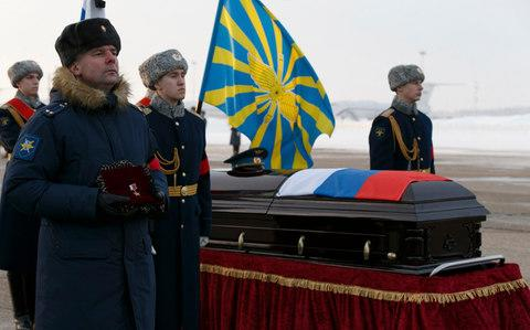 A memorial ceremony for Russian air force pilot Roman Filipov, who killed himself with a grenade after his aircraft was shot down over Syria this month - Credit: Vadim Savitsky/Handout via Reuters