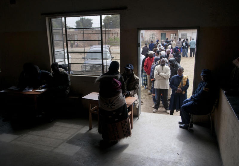 Zimbabweans queue to cast their votes in the country's general elections in Morondera, rural Zimbabwe, Wednesday July 31, 2013. Posing one of the biggest threats to President Robert Mugabe's 33-year grip on power, Zimbabweans flocked to polling stations Wednesday in a presidential election that will determine the course of this southern African country even as suspicions were high that vote-counting could be rigged. (AP Photo/Skyler Reid) SOUTH AFRICA OUT