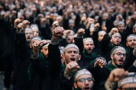 FILE PHOTO: Lebanon's Hezbollah supporters chant slogans during last day of Ashura in Beirut