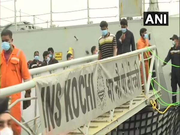 INS Kochi arrives in Mumbai with rescuees from Barge P305. (Photo/ ANI)