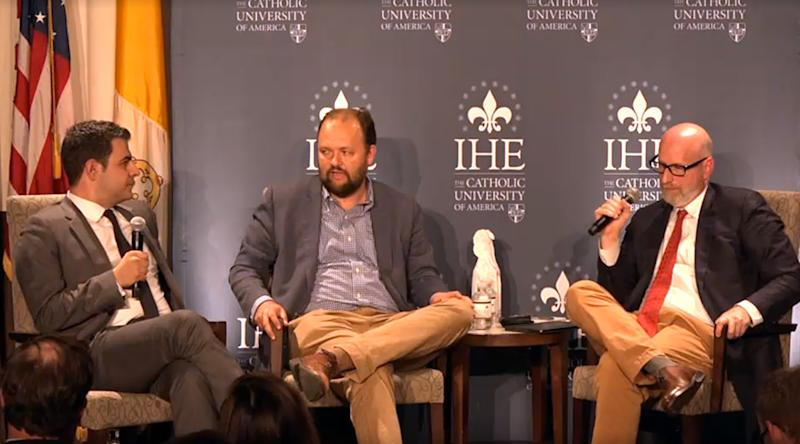 New York Times columnist Ross Douthat, center moderates debate between Ahmari and French. (Photo: Vimeo)