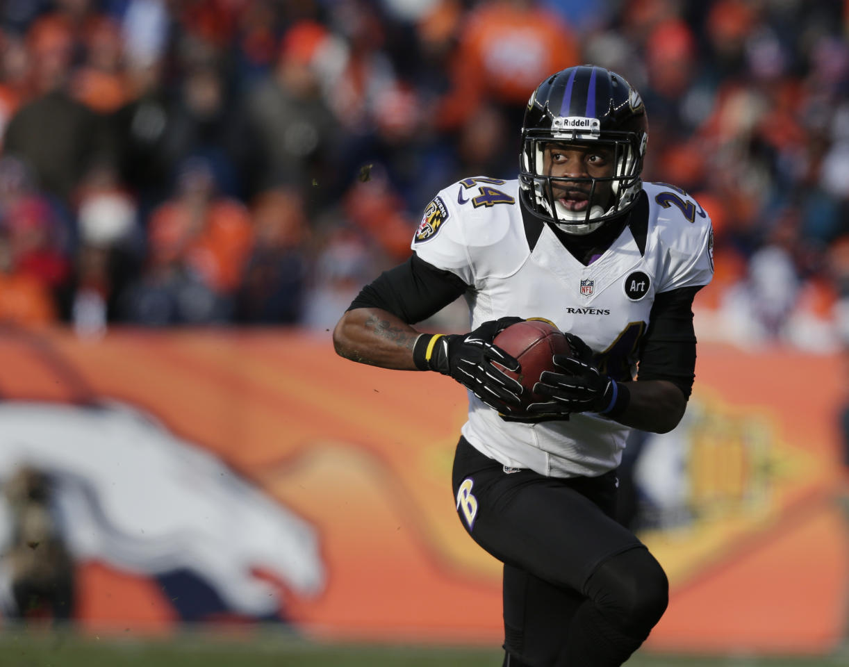 Baltimore Ravens cornerback Corey Graham returns an interception for a touchdown against the Denver Broncos in the first quarter of an AFC divisional playoff NFL football game, Saturday, Jan. 12, 2013, in Denver. (AP Photo/Joe Mahoney)