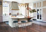 <p>Designed by Matthew Quinn, this kitchen island was customized with a dog bed to accomodate the family's best friend. </p>