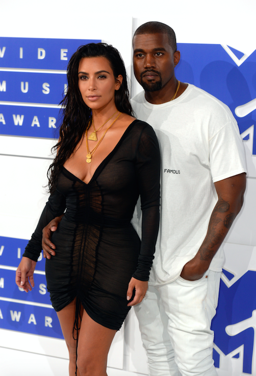 Kim Kardashian and Kanye West are reportedly expanding their brood via a surrogate [Photo: PA]