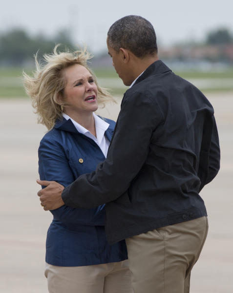 President Barack Obama is greeted by Oklahoma Gov. Mary Fallin as he arrives Sunday, May 26, 2013, at Tinker Air Force Base in Midwest City, Okla., en route to the Moore, Okla., to see the response to the severe tornadoes and weather that devastated the area. He will also visit with the families affected, and first responders. (AP Photo/Carolyn Kaster)