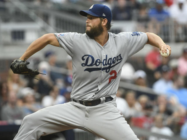Los Angeles Dodgers starting pitcher Clayton Kershaw pitches against the Atlanta Braves during the first inning of a baseball game Friday, July 27, 2018, in Atlanta. (AP Photo/John Amis)