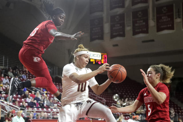 Boston College guard Makayla Dickens (10) tries to control the ball between Louisville guards Jazmine Jones (23) and Mykasa Robinson (5) during the first half of an NCAA college basketball game Thursday, Jan. 16, 2020, in Boston. (AP Photo/Elise Amendola)