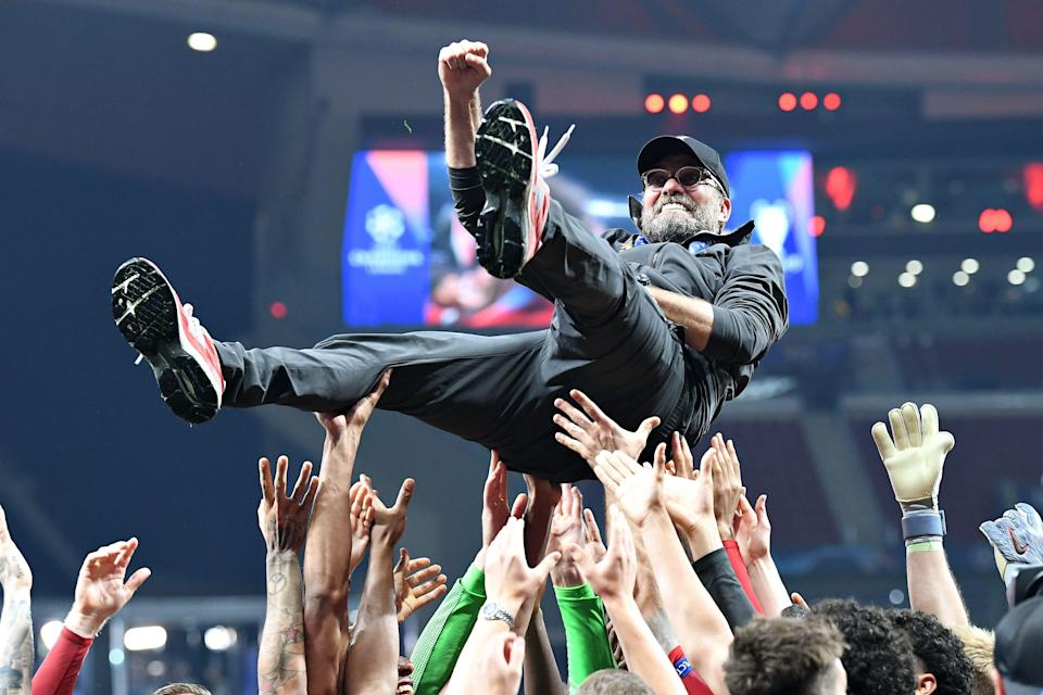 MADRID, SPAIN - JUNE 01: Jurgen Klopp, Manager of Liverpool is thrown in the air as he celebrates with his players and staff after winning the UEFA Champions League Final between Tottenham Hotspur and Liverpool at Estadio Wanda Metropolitano on June 01, 2019 in Madrid, Spain. (Photo by Stuart Franklin - UEFA/UEFA via Getty Images)