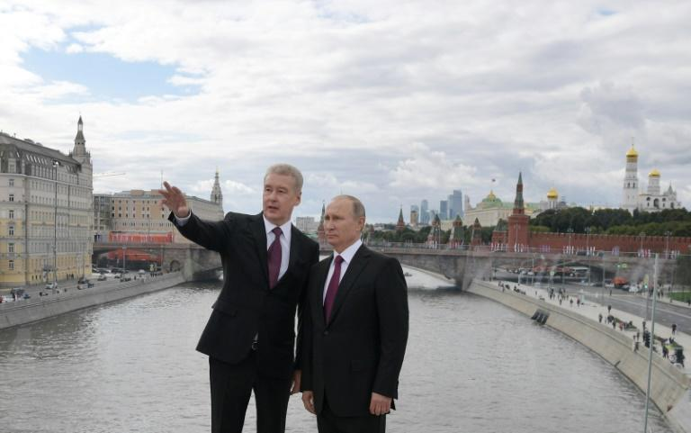 Moscow Mayor Sergei Sobyanin (L) is backed by Russian President Vladimir Putin for re-election on Sunday